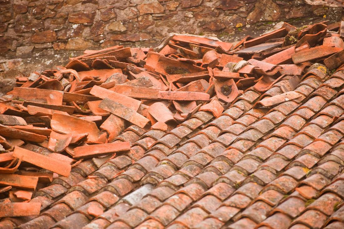 ​This is a picture of a storm damaged roofs.